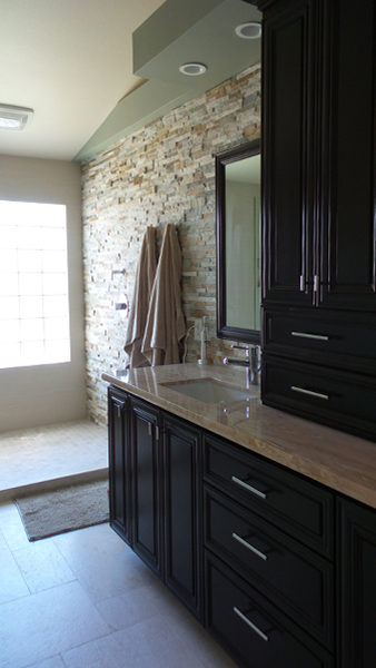 Custom Cabinetry, Tower Storage, And Stone Stack Wall