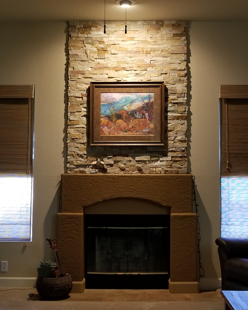 Stonework added above fireplace